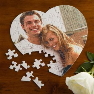 couple pictured in heart-shaped jigsaw puzzle